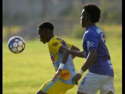 Andre Fletcher (left) of Waterhouse FC shields the ball from Vere United defender Ray Campbell during their Red Stripe Premier League encounter at Drewsland on September 12, 2019.