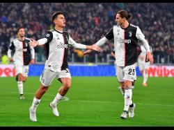 Juventus' Paulo Dybala jubilates after scoring the goal (1-0) during the Italian Serie A match Juventus FC vs AC Milan at Allianz stadium in Turin, Italy, yesterday.