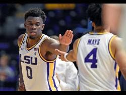 LSU forward Darius Days (0) celebrates the apparent win with teammate Skylar Mays (4) in the second half of an NCAA college basketball game on November 16, 2019.