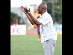 Leebert Halliman, coach of Excelsior High School, gesticulates to his players during their Walker Cup semi-final football match against Camperdown High  on November 21, 2019.