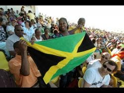 below: Spectators beam with joy at the opening ceremony of the 2007 Cricket World Cup at the Trelawny Multipurpose Stadium.
