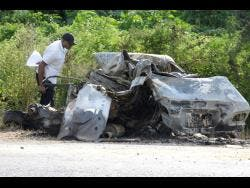 This car burst into fire along Chesterfield Drive in St Andrew last week after being involved in a three-vehlicle crash. Two persons died in the accident.