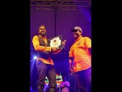 Beenie Man receives an award from Patrick Roberts, the engine behind Ghetto Splash.