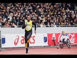 In this photo provided by Japan Sports Council (JSC), Olympic gold medallist Usain Bolt (left) of Jamaica runs at the opening ceremony of the new National Stadium, the main venue for the Tokyo 2020 Olympic and Paralympic Games, in Tokyo, Japan, on December 21, 2019.