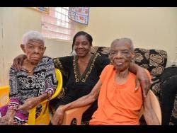 Kenyon Hemans/Photographer Beverly Young hugs her two moms,  Hyacinth Wallace (left) and Alberta McLeod-Young.