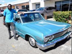 Glenford Thorpe with his 1963 Chevrolet Impala.