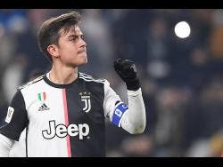 Juventus' Paulo Dybala celebrates after scoring during the Italian Cup match against Udinese at the Allianz Stadium in Turin, Italy, yesterday.