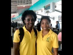 Sunshine Girls Shannika Johnson (left) and Shadian Hemmings at the Norman Manley International Airport yesterday.