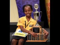 Toriann Beckford poses with The Gleaner's Children's Own Spelling Bee trophy after winning the national final on Wednesday.
