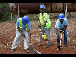 Minister of Local Government Desmond McKenzie (centre) is joined by Member of Parliament for St Elizabeth South East Franklyn Witter (left) and Councillor Cetany Holness in breaking ground for the construction of an $11-million water shop in Tryall, St Elizabeth, on February 14.