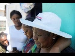 Marjorie Powell (right) is overcome with grief as she mourns the loss of her son.
