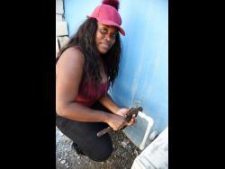 Denham Town resident Kamau Brown.