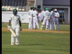 Scorpions batsman Jermaine Blackwood walks back to the pavilion after being dismissed by Veerasammy Permaul in the West Indies Championship match in Trelawny on February 29, 2019.