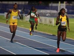 Jamaica's Shaquena Foote (left) speeds to victory in the Under-20 Girls 400m hurdles at the Carifta Games in the Cayman Islands on April 21, 2019.