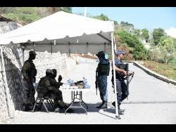 Security forces monitoring Seven Miles and Eight Miles in Bull Bay, St Andrew, now under quarantine.