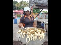 Munchie, one of the crab vendors at Heroes Circle in Kingston.