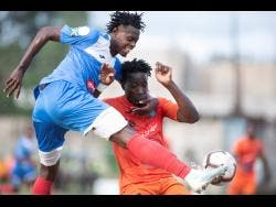 Chavany Willis (left) of Portmore United takes a shot at goal ahead of Tivoli Gardens FC's Jabeur Johnson during a Red Stripe Premier League match at the Spanish Town Prison Oval in St Catherine on Sunday, March 1.