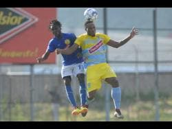 Waterhouse defender Shawn Lawes (right) engages Vere United defender Devroy Grey in an aerial battle for possession during their Red Stripe Premier League game at the Drewsland Stadium on Thursday, September 12, 2019.