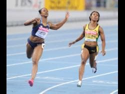 Jamaica's Shelly-Ann Fraser-Pryce (right) crosses the finish line behind American Carmelita Jeter in the women's 100 metres final at the 2011 World Athletics Championships. Jeter won in 10.90 seconds, while Fraser-Pryce placed fourth in 10.99.