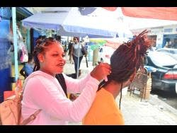 Luceana Thomas says that business has been very slow since COVID-19 came to Jamaican shores.
