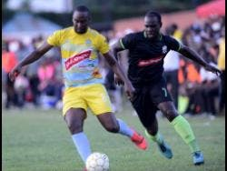 Waterhouse FC's Nicholi Finlayson (left) shields the ball from Molynes United's Devon Hodges during their Red Stripe Premier League match at the Constant Spring Sports Complex on Sunday, November 3, 2019.
