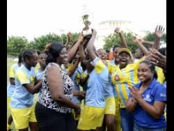 Waterhouse Women FC celebrate with their JFF Women's League Mid Season final trophy after defeating Arnett Gardens 2-1 in the final on Sunday, August 19, 2018.