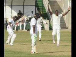 Jamaica Scorpions all-rounder Rovman Powell (right) successfully appeal for leg before wicket against Trinidad and Tobago Red Force batsman Darren Bravo (left) on the first day of their Cricket West Indies Regional Four-Day Championship cricket match at Sabina Park on Thursday, January 10, 2019. Red Force's Jason Mohammed is the other batsman pictured.