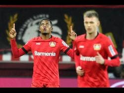 Bayer Leverkusen's Leon Bailey (left) celebrates after scoring during the German Bundesliga  match against Borussia Dortmund in Leverkusen, Germany, on February 8.