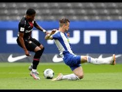 Bayer Leverkusen's Leon Bailey (left) challenges Hertha Berlin's Peter Pekarik for the ball during a German Bundesliga match in Berlin, Germany, on Saturday.