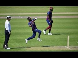 Pacer Marquino Mindley runs in to bowl a delivery for Brathwaite's XI during a Windies squad training match against Holder's XI at Old Trafford in Manchester, England, yesterday.