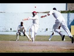 Franklyn Rose bowls to Jimmy Adams during a Jamaica first-class team's practice match at Sabina Park in 1994.