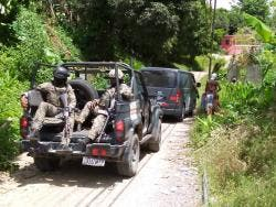 Security forces patrol sections of Amity.