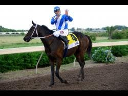 """File WOW WOW with Ameth Robles aboard wins the Pick 3 """"Super Challenge"""" Trophy over 1400 metres at Caymans Park on Saturday, November 30, 2019."""