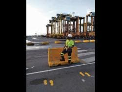 Donna Marie Vernon is one of two female crane operators at the Kingston Freeport Terminal.