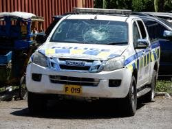 The police vehicle that was damaged by defiant partygoers in Parry Town, St Ann.