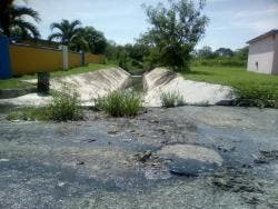 Raw sewage seeping on to the roadway has been a problem for some residents of Innswood Village in St Catherine.