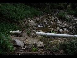 Heavy rains last month caused damage to crucial water-carrrying pipes in St Thomas.