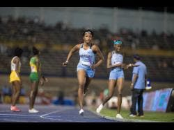 Rushana Dwyer of Edwin Allen High School competes in the 4x800m high school open relays at the Gibson/McCook Relays, held at the National Stadium on February 29.