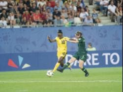 Jamaica's Jody Brown (left) dribbles away from Australia's Karly Roestbakken in a first round match at the FIFA Women's World Cup in 2019.