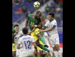 File Jamaica's Romario Williams (second right) tries to make a shot on goal against El Salvador's Darwin Ceren (right) during a Concacaf Gold Cup match in San Antonio in  July 2017.