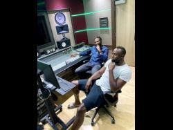 NJ (left) and Usain Bolt in the studio.