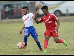 FILE Portmore United's Maalique Foster shrugs off a challenge from UWI's Allando Brown during their Redstripe Premier league semi final at UWI Bowl on Sunday, May 28, 2017.