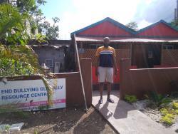 Antonio McKoy in front of Le Antonio's Foundation and Resources Centre.