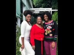 Rosemarie Scott (centre) is flanked by daughters Zaneta (left) and Zuri.