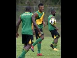 File National player Javain Brown (centre) takes part in a training session with the Jamaica Under- 23 team.