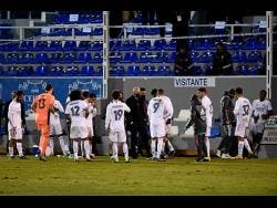 AP Real Madrid's head coach Zinedine Zidane (centre) speaks with his players as the Spanish Copa del Rey round of 32 match between Alcoyano and Real Madrid goes into extra time at the El Collao stadium in Alcoy, Spain, Wednesday, January 20.