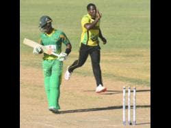 Jamaica Scorpions captain Rovman Powell celebrates after removing Windward Islands Volcanoes batsman Kevin Stoute during their Cricket West Indies Regional Super50 encounter at the Coolidge Cricket Ground in Antigua on Tuesday.