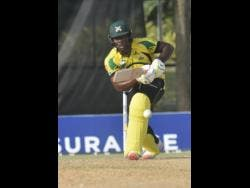 Jamaica Scorpions' Odean Smith drives through the off side during his unbeaten innings of 68 as his team beat the Barbados Pride on February 21, 2021 to advance to the semi-final of Regional Super50 cricket competition.