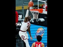 Illinois centre Kofi Cockburn goes up for a dunk against Ohio State in an NCAA college championship game at the Big Ten Conference tournament in Indianapolis on Sunday, March 14.