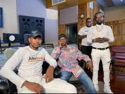 From left: Juke Boxx Productions' Shane Brown, Beres Hammond and Popcaan take a break from their studio session, while one of the label's composers, Kiman Burnette (background) looks on.